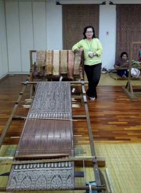 The curator Janet Rata Noel in the studio with some examples of weavers' work